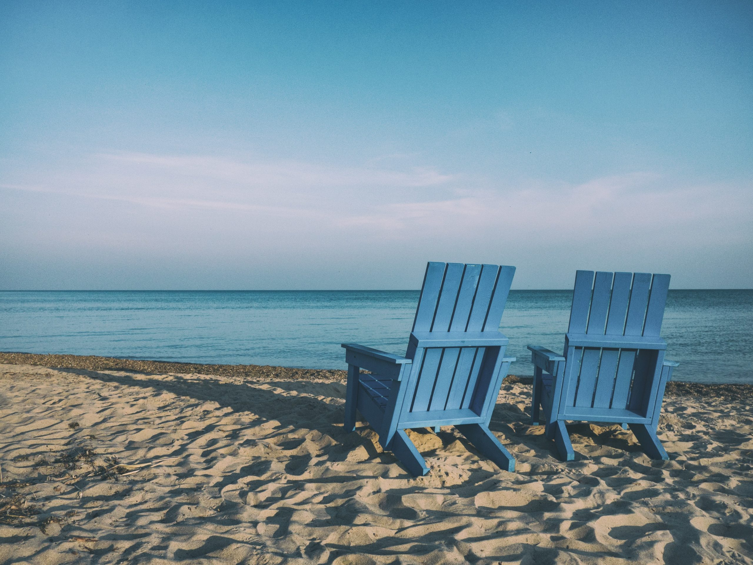 Two Empty chairs on the beach